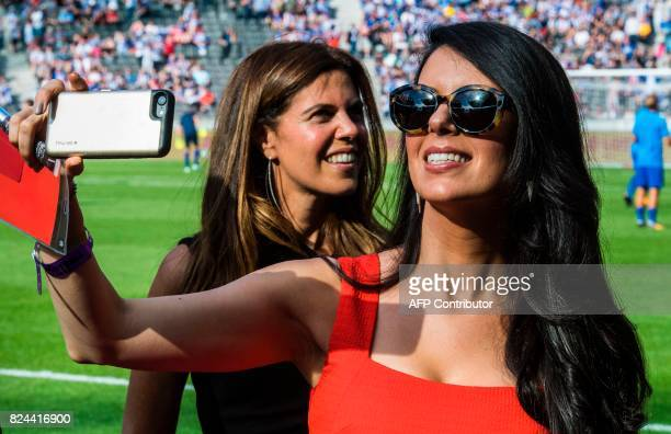 Linda Pizzuti Henry managing director of the Boston Globe newspaper and wife of US businessman and coowner of Liverpool FC John Henry shoots a video...