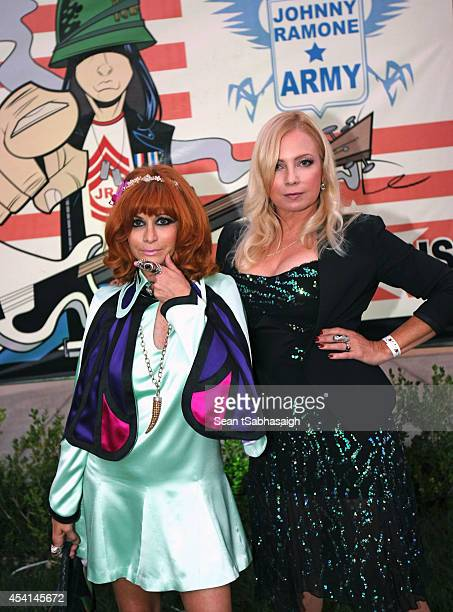 Linda Ramone and actress Tracy Lords pose back stage at the Johnny Ramone 10th Anniversary Celebration at Hollywood Forever on August 24 2014 in...