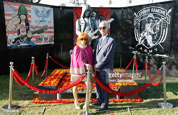Linda Ramone and director John Waters pose in front of Johnny Ramone bronze statue at the 9th Annual Johnny Ramone Tribute at Hollywood Forever on...