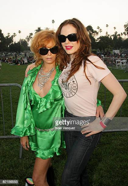 Linda Ramone and Rose McGowan attend the Tribute To Johnny Ramone at the Forever Hollywood Cemetery on August 1 2008 in Los Angeles California