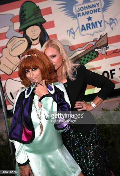 Linda Ramone and Tracy Lords pose back stage at the Johnny Ramone 10th Anniversary Celebration at Hollywood Forever on August 24 2014 in Hollywood...