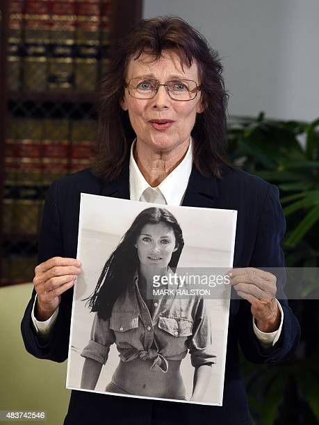 Linda Ridgeway Whitedeer one of three new alleged sexual assault victims of comedian Bill Cosby holds a younger photo of herself during a news...
