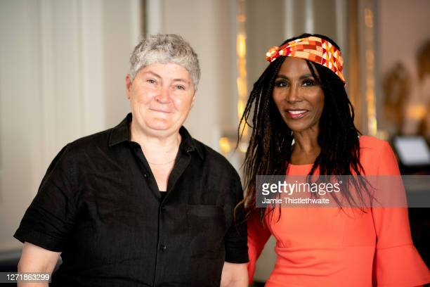 """Linda Riley and SInitta pose for a photo during the """"Henpire"""" podcast launch event at Langham Hotel on September 10, 2020 in London, England."""