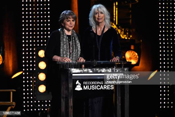 Linda Ronstadt and Emmylou Harris speak onstage during MusiCares Person of the Year honoring Dolly Parton at Los Angeles Convention Center on...