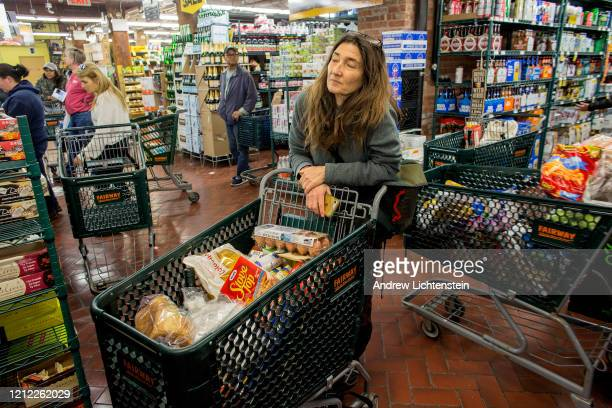 Linda Rosier a mother of two stocks up on essential long term food supplies as concerns about the spreading COVID19 are keeping the kids out of...
