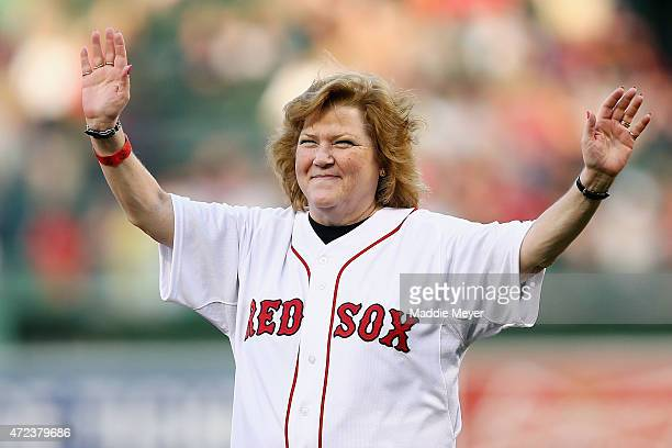 Linda Ruth Tossetti granddaugher of Babe Ruth waves to the crowd before throwing out the first pitch before the game between the Boston Red Sox and...