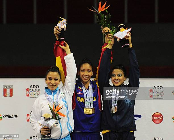 Linda Sandoval Maldonado of Guatemala Michelle Sanchez Salazar of Venezuela and Geraldine Perez Quito of Ecuador pose in the podium of ribbons...