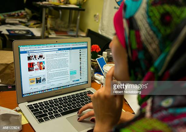 Linda Sarsour executive director of the ArabAmerican Association of New York reads a critical Facebook message October 28 2014 in the Brooklyn...