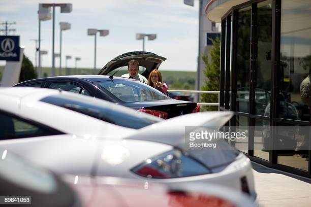 Linda Sedacca looks at new Mitsubishi Eclipse vehicles with help of salesman Stoyan Cincarov at Mile High Mitsubishi in Denver Colorado US on Friday...