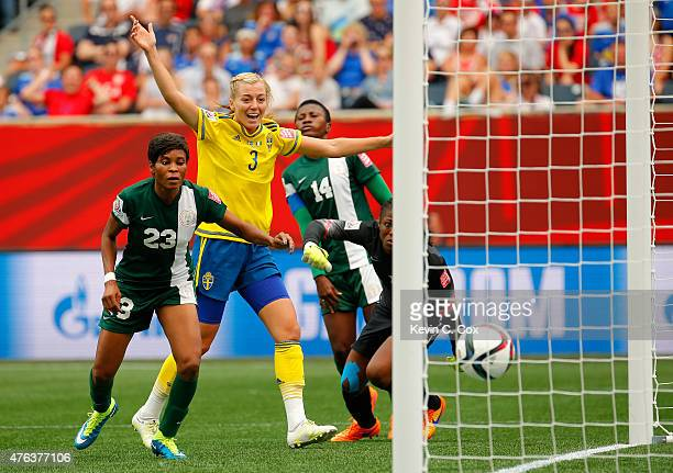 Linda Sembrant of Sweden reacts after scoring the third goal against goalkeeper Precious Dede and Ngozi Ebere of Nigeria during the FIFA Women's...