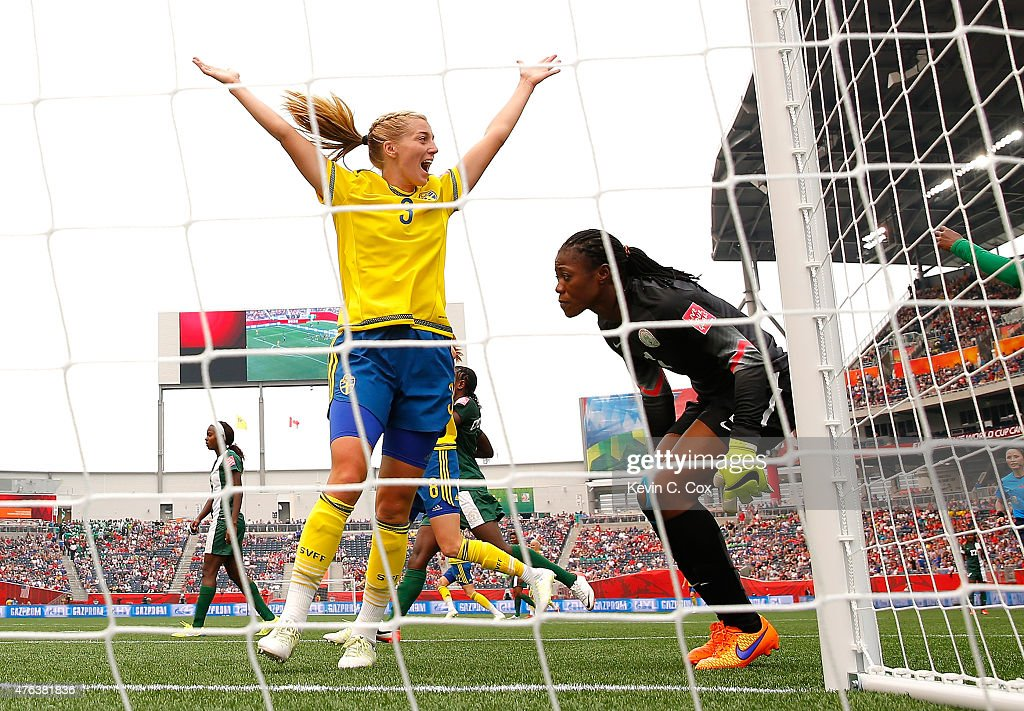 Linda Sembrant #3 of Sweden reacts after scoring the third goal against goalkeeper Precious Dede #1 and Ngozi Ebere #23 of Nigeria during the FIFA Women's World Cup Canada 2015 Group D match between Sweden and Nigeria at Winnipeg Stadium on June 8, 2015 in Winnipeg, Canada.