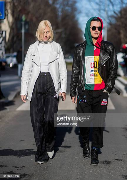 Linda Tol and Alessandro Enriquez is wearing leather jackets is seen at Armani during Milan Men's Fashion Week Fall/Winter 2017/18 on January 14 2017...