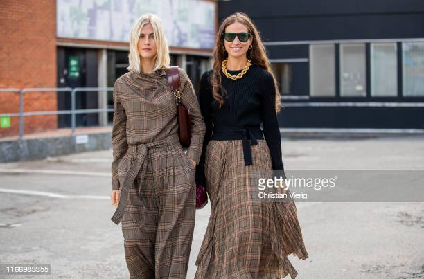 Linda Tol and Erika Boldrin seen wearing brown plaid skirt and wide leg pants, top outside By Malene Birger during Copenhagen Fashion Week...