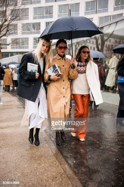 Linda Tol Evangeline Smyrniotaki and Loulou de Saison are seen in the streets of Paris after the Loewe show during Paris Fashion Week Womenswear...