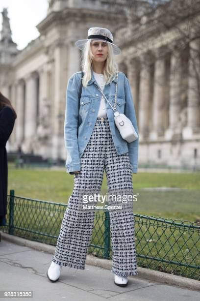 Linda Tol is seen on the street attending Chanel during Paris Women's Fashion Week A/W 2018 wearing a denim jacket with Chanel hat on March 6 2018 in...