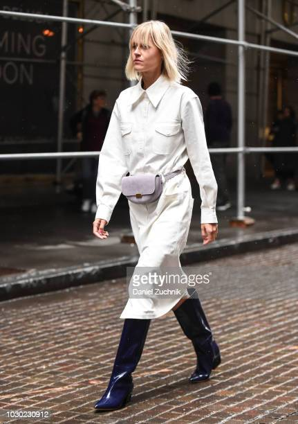 Linda Tol is seen wearing a white coat, purple rainboots and purple purse outside the Tibi show during New York Fashion Week: Women's S/S 2019 on...