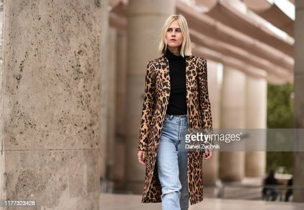 Linda Tol is seen wearing an animal print coat black sweater blue jeans and black leather boots outside the Paco Rabanne show during Paris Fashion...