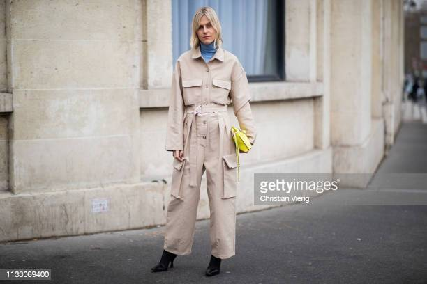 Linda Tol is seen wearing beige overall outside Nina Ricci during Paris Fashion Week Womenswear Fall/Winter 2019/2020 on March 01 2019 in Paris France