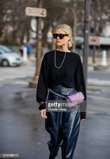 Linda Tol is seen wearing black jumper, navy cropped leather pants, pink fanny bag outside Chanel during Paris Fashion Week - Womenswear Fall/Winter...