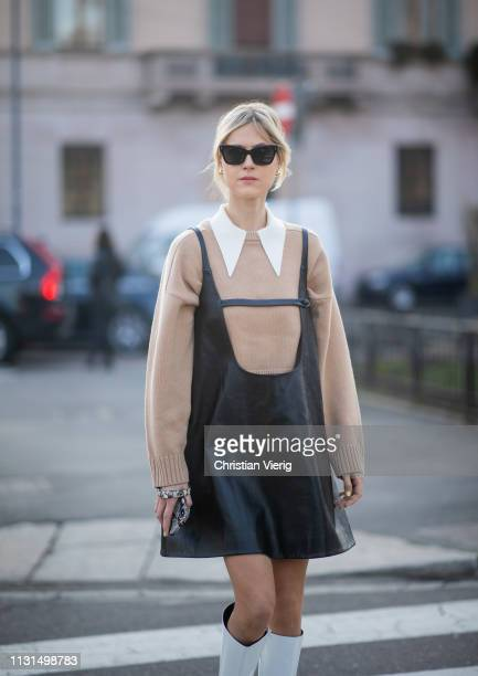 Linda Tol is seen wearing black leather dress, white boots outside Tods on Day 3 Milan Fashion Week Autumn/Winter 2019/20 on February 22, 2019 in...