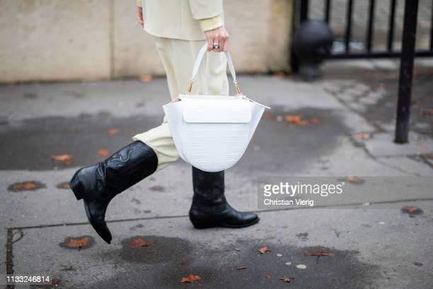 Linda Tol is seen wearing blazer jacket, pants, white Wangler bag, cowboy boots outside Elie Saab during Paris Fashion Week Womenswear Fall/Winter...