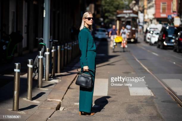 Linda Tol is seen wearing button shirt wide leg pants black bag outside Attico during Milan Fashion Week Spring/Summer 2020 on September 19 2019 in...
