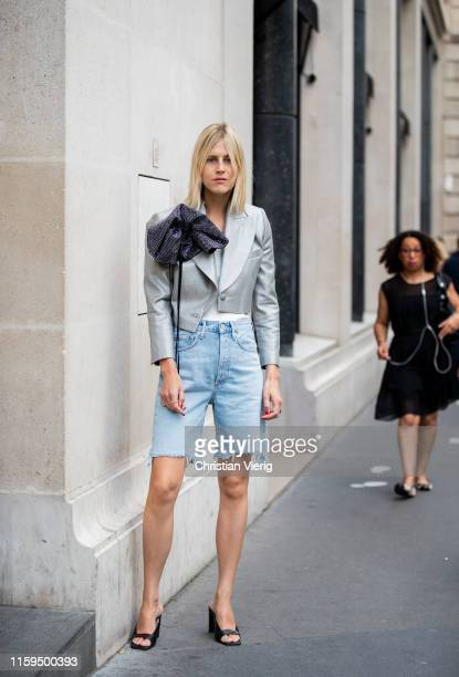 Linda Tol is seen wearing jeans shorts grey cropped blazer outside Schiaparelli during Paris Fashion Week Haute Couture Fall/Winter 2019/2020 on July...