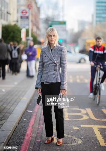 Linda Tol is seen wearing plaid blazer outside Shrimps during London Fashion Week February 2019 on February 19 2019 in London England