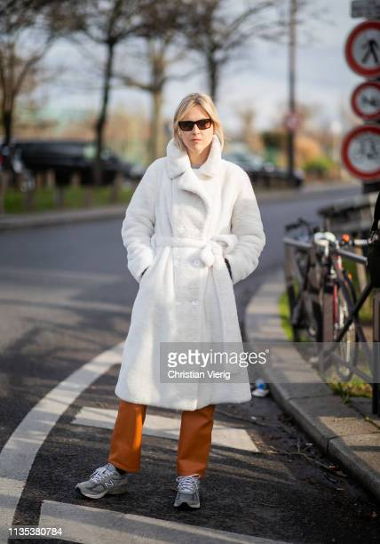 Linda Tol is seen wearing white belted coat outside Lacoste during Paris Fashion Week Womenswear Fall/Winter 2019/2020 on March 05, 2019 in Paris,...