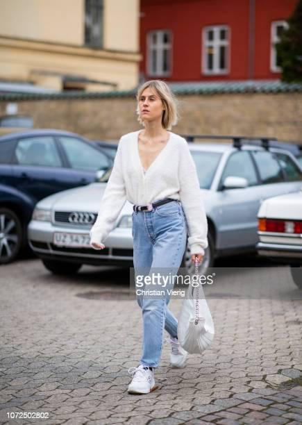 Linda Tol is seen wearing white blouse, denim jeans, white bag outside Samsoe Samsoe Autumn 2019 Re-see on December 13, 2018 in Copenhagen, Denmark.