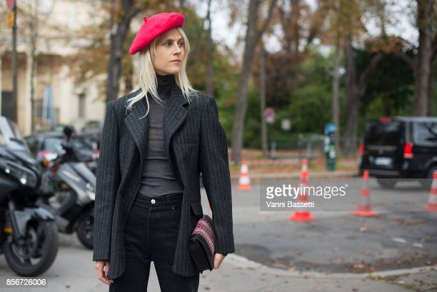 Linda Tol poses after the Sacai show at the Grand Palais during Paris Fashion Week Womenswear SS18 on October 2 2017 in Paris France
