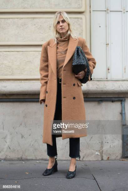 Linda Tol poses after the Valentino show at the Lycee Carnot during Paris Fashion week Womenswear SS18 on October 1 2017 in Paris France