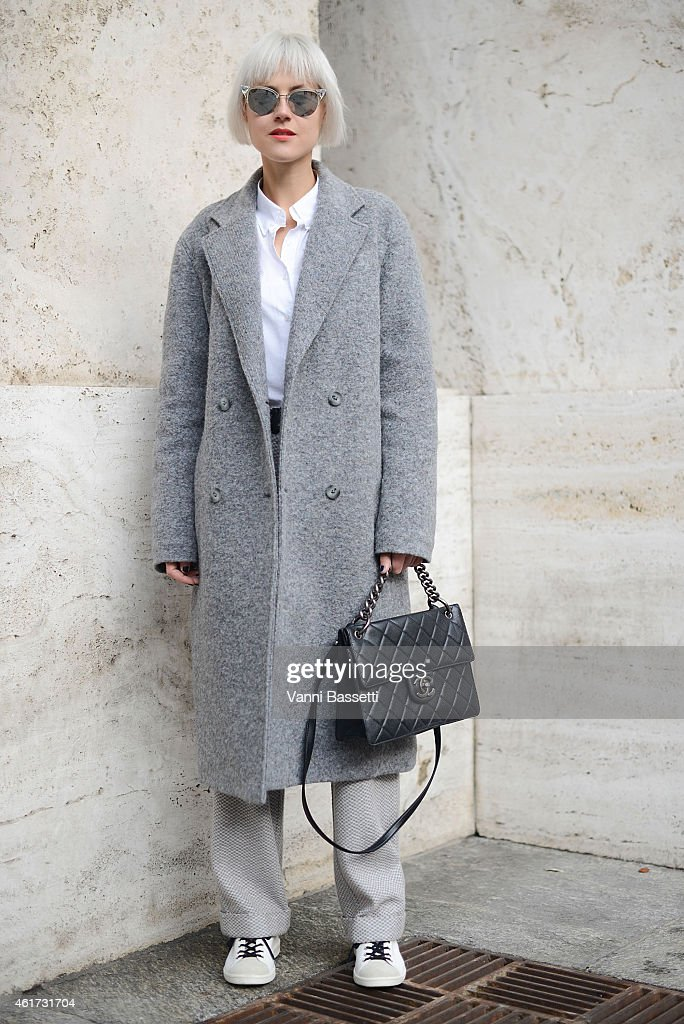 Linda Tol poses wearing Alexander Wang coat, Missoni pants, Chanel bag, Isabel Marant shoes and Fendi sunglasses during day 2 of Milan Menswear Fashion Week Fall/Winter 2015/2016 on January 18, 2015 in Milan, Italy.