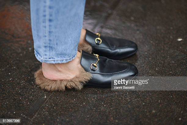 Linda Tol poses wearing Gucci loafers before the Jil Sander show during the Milan Fashion Week Fall/Winter 2016/17 on February 27 2016 in Milan Italy