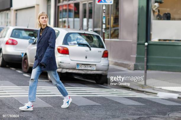 Linda Tol seen wearing a stripped blazer and Diadora shoes after the Sacai Fall/Winter 2018 show on March 5 2