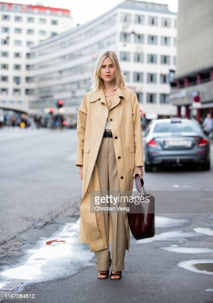 Linda Tol seen wearing beige trench coat, high waist pants outside Ganni during Copenhagen Fashion Week Spring/Summer 2020 on August 08, 2019 in...