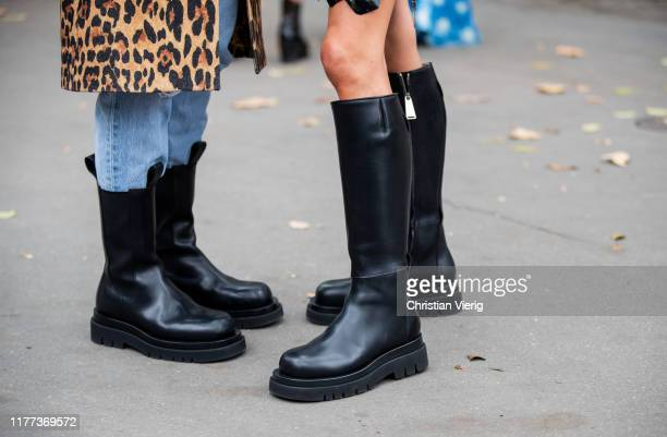 Linda Tol seen wearing denim jeans, black boots, coat with animal leopard print and Chloe Harrouche wearing black boots outside Paco Rabanne during...