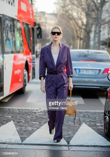 Linda Tol seen wearing purple cropped blazer and pants brown bag sunglasses outside Schiaparelli during Paris Fashion Week Haute Couture...