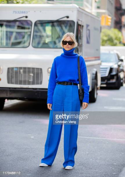 Linda Tol seen weraing blue turtleneck and pants during New York Fashion Week September 2019 on September 09 2019 in New York City