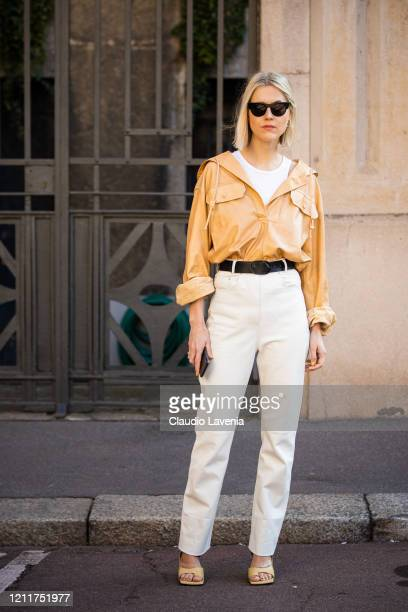Linda Tol, wearing a beige leather shirt, cream leather pants and beige sandals, is seen outside Salvatore Ferragamo show, during Milan Fashion Week...