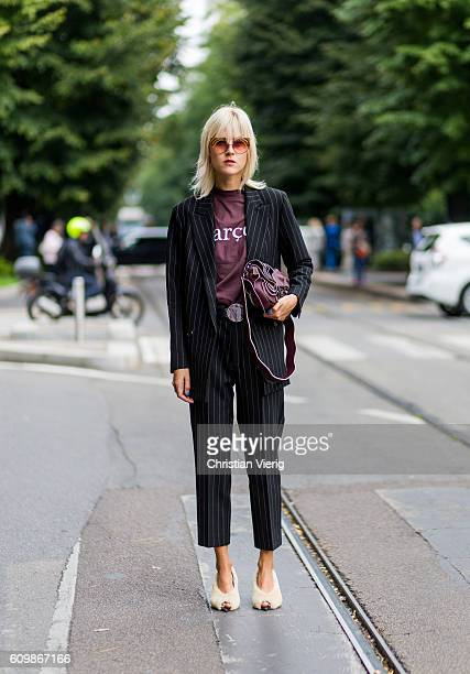 Linda Tol wearing a black white suit outside Fendi during Milan Fashion Week Spring/Summer 2017 on September 22 2016 in Milan Italy