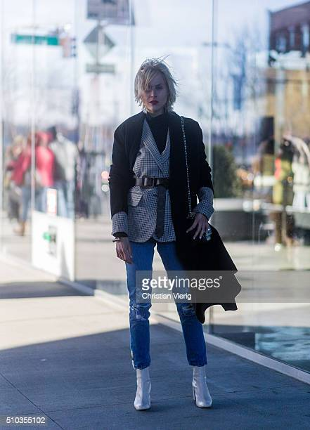 Linda Tol wearing a black wool coat and a black Louis Vuitton bag seen outside Tibi during New York Fashion Week Women's Fall/Winter 2016 on February...
