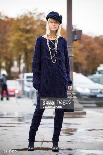 Linda Tol wearing a blue knitted dress Chanel necklace blue over the knees boots blue baker boy hat and blue Chanel bag is seen before the Chanel...
