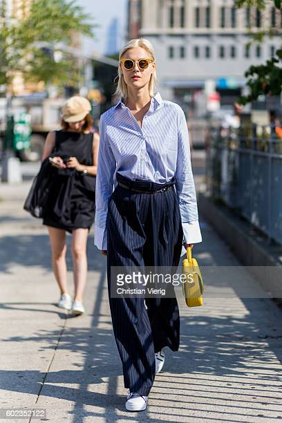 Linda Tol wearing a button shirt with long sleeves outside Lacoste on September 10 2016 in New York City