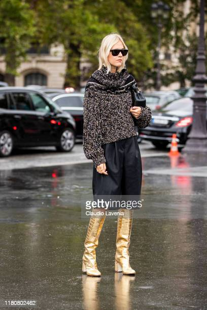 Linda Tol, wearing a decorated jumper, black leather shorts and gold boots, is seen outside the Chanel show during Paris Fashion Week - Womenswear...