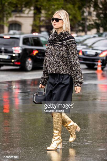 Linda Tol wearing a decorated jumper black leather shorts and gold boots is seen outside the Chanel show during Paris Fashion Week Womenswear Spring...