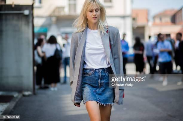 Linda Tol wearing a denim mini skirt grey blazer white tshirt boots is seen outside Diesel during Milan Men's Fashion Week Spring/Summer 2018 on June...