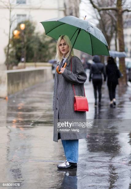 Linda Tol wearing a grey vintage coat outside Mugler on March 4 2017 in Paris France