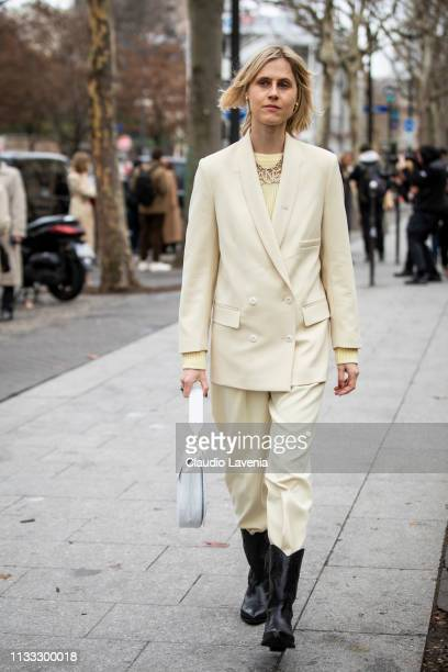 Linda Tol wearing a light yellow suit white bag and black boots is seen outside Altuzarra on Day 6 Paris Fashion Week Autumn/Winter 2019/20 on March...