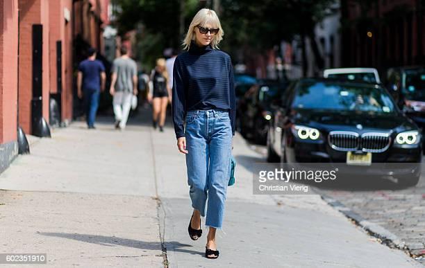 Linda Tol wearing a long shirt and denim jeans outside Tibi on September 10 2016 in New York City